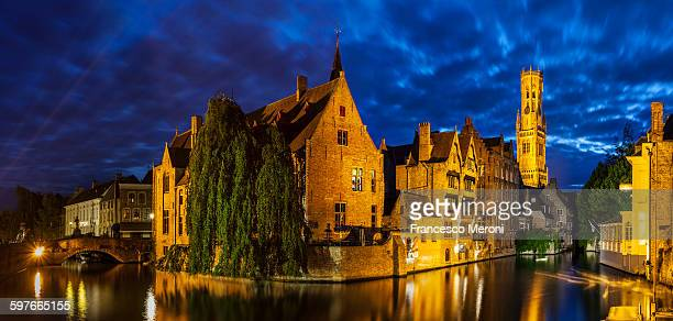 Canal waterfront and historic buildings at night, Bruges, Belgium