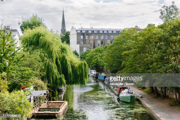 canal with boats and residential buildings in camden town, london, uk - idyllic stock pictures, royalty-free photos & images
