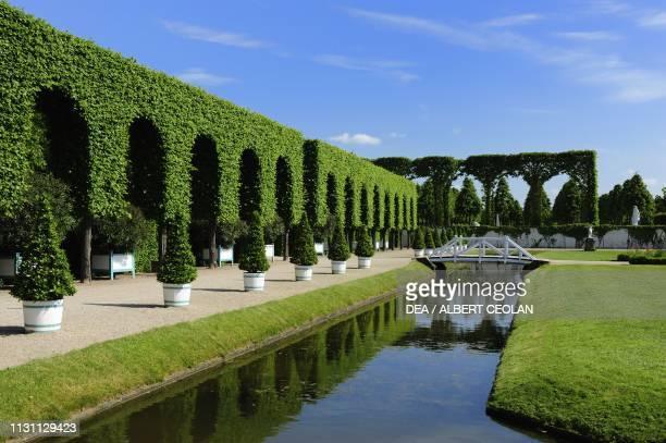 Canal with bridge in the garden of Schwetzingen Castle BadenWurttemberg Germany