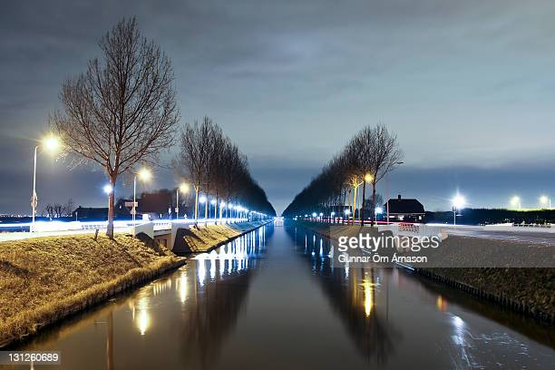 canal with treeline - gunnar örn árnason stock pictures, royalty-free photos & images