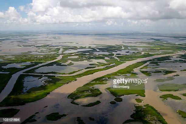 Canals created for navigation and oil and gas pipelines cut through the marsh off the coast of Louisiana US on Monday July 26 2010 BP Plc returned to...
