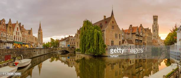canals, houses, rozenhoedkaai and belfry of bruges, belgium - bruges stock pictures, royalty-free photos & images