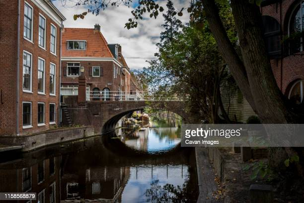 canals with boats from appingedam holland - giethoorn stock pictures, royalty-free photos & images
