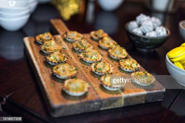 Canapes on the wooden chopping board