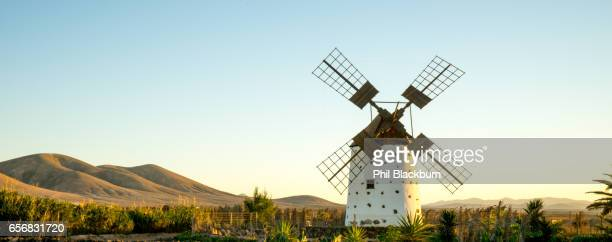 canarian windmill near el cotillo, fuerteventura - old windmill stock photos and pictures