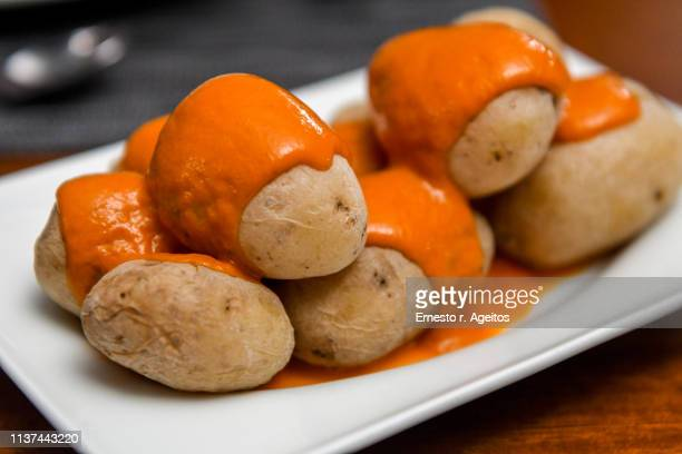 """canarian wrinkly potatoes with """"mojo"""" (hot sauce) - las palmas de gran canaria stock pictures, royalty-free photos & images"""