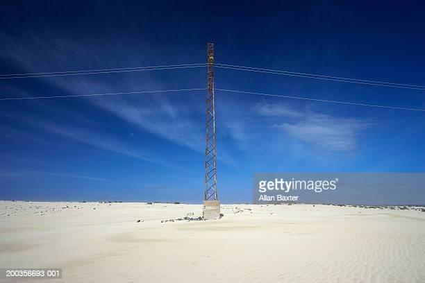 Canary Islands, Fuerteventura, pylons and tower in desert landscape