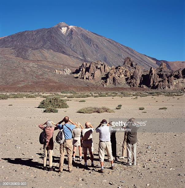 canary islands, tenerife, tourists looking at pico de teide, rear view - pico de teide stock pictures, royalty-free photos & images