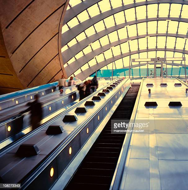 canary warf underground station, going up with the escalators - marcoventuriniautieri stock pictures, royalty-free photos & images
