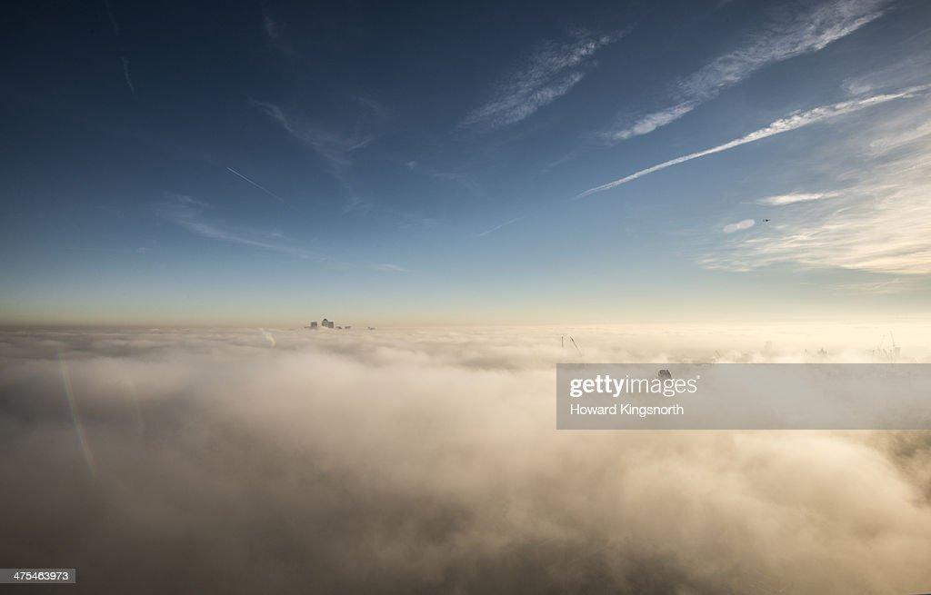 Canary Wharf above the cloudbase : Stock Photo