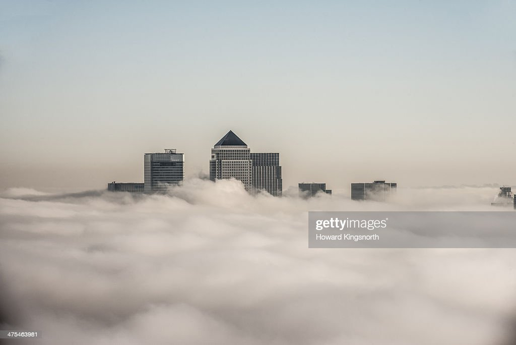 canary Wharf above the clouds : Stock Photo