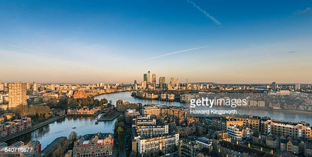 canary wharf and east london at sunset - london docklands stock pictures, royalty-free photos & images