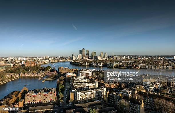 canary wharf and east london at sunset - east london stock pictures, royalty-free photos & images