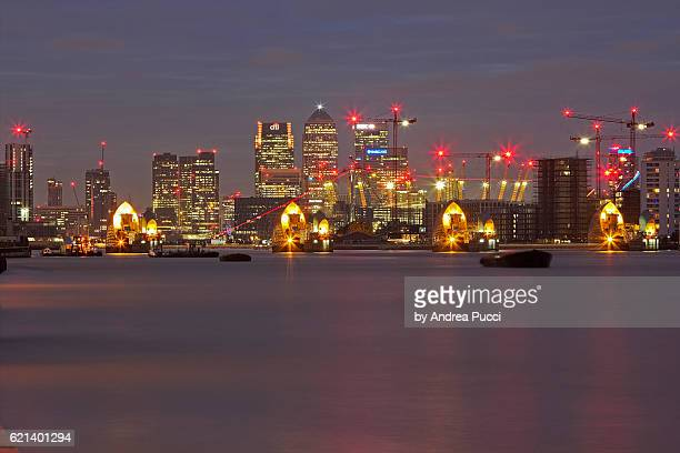 canary wharf and thames barrier from woolwich, london, united kingdom - woolwich stock pictures, royalty-free photos & images