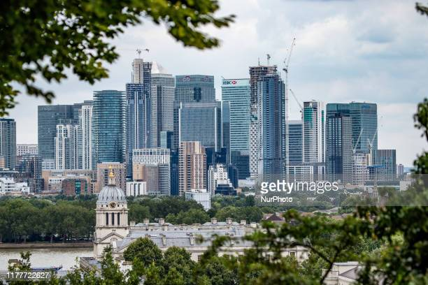 Canary Wharf as seen in epic cloudy panoramic view Maritime Museum Old Royal Naval College and London Skyline from Greenwich Park during the day in...