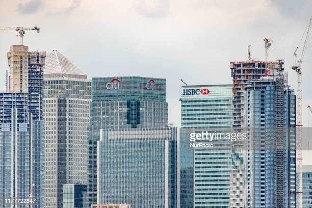 Canary Wharf as seen in epic cloudy panoramic view, Maritime Museum, Old Royal Naval College and London Skyline from Greenwich Park during the day in...