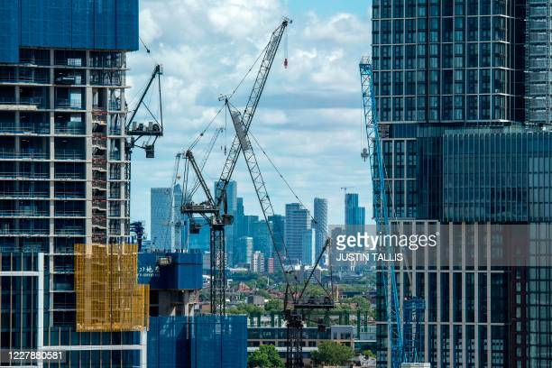 Canary Wharf financial district is seen in the distance as construction work continues on the One Nine Elms development site in south west London on...