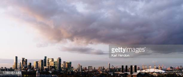 canary wharf skyline, london at sunset - stock photo - the o2 england stock pictures, royalty-free photos & images