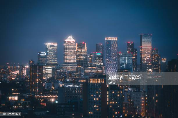 canary wharf skyline view at night - financial hub in london, united kingdom - greater london stock pictures, royalty-free photos & images
