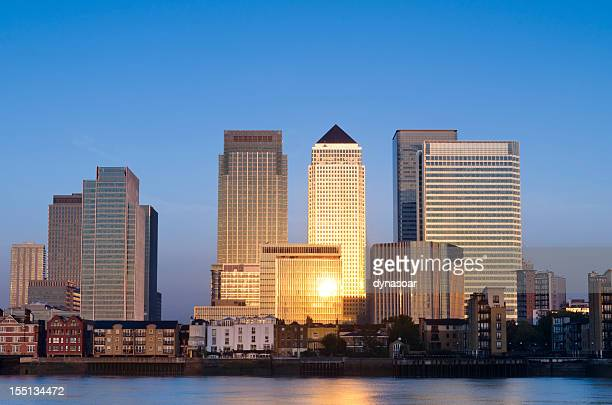 canary wharf skyscrapers sunrise, london - canary wharf stock photos and pictures