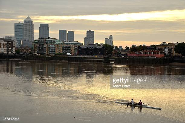 CONTENT] Canary Wharf stands over the River Thames as dawn light breaks through the clouds A couple are out on the river for an early morning sports...