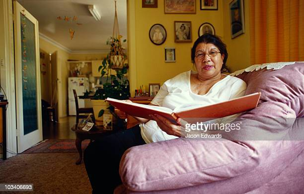 A member of the Stolen Generation reads entries in a Sorry Day book.