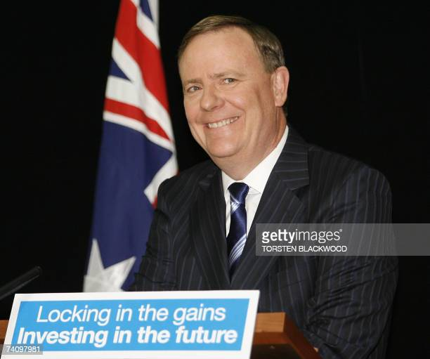 Australian Treasurer Peter Costello smiles as he announces generous tax cuts in the federal budget during a press conference at Parliament House in...
