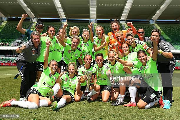 Canberra players and coaching support staff celebrate winning the WLeague Grand Final match between Perth and Canberra at nib Stadium on December 21...