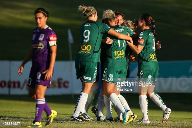 Canberra players celebrate a goal by Ashleigh Sykes during the round six WLeague match between the Perth Glory and Canberra United at Percy Doyle...