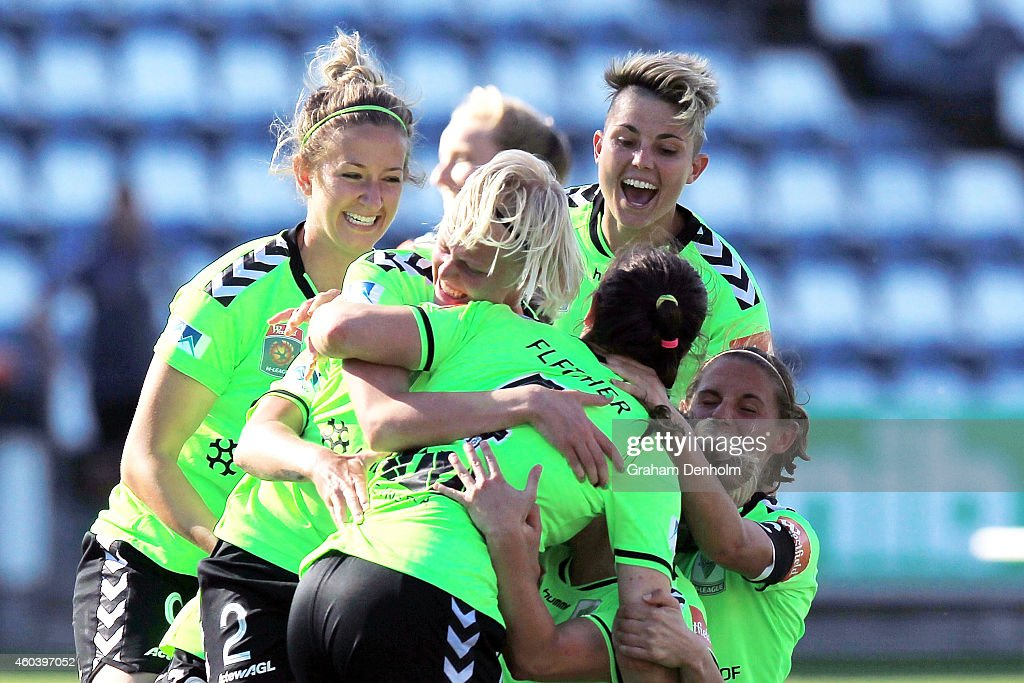 Canberra United celebrate victory in the W-League Semi Final match between Melbourne Victory and Canberra United at Simonds Stadium on December 13, 2014 in Geelong, Australia.