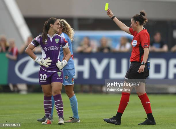 Canberra United goalkeeper Shamiran Khamis is shown the yellow card by referee Kate Jacewicz during the round nine W-League match between Melbourne...