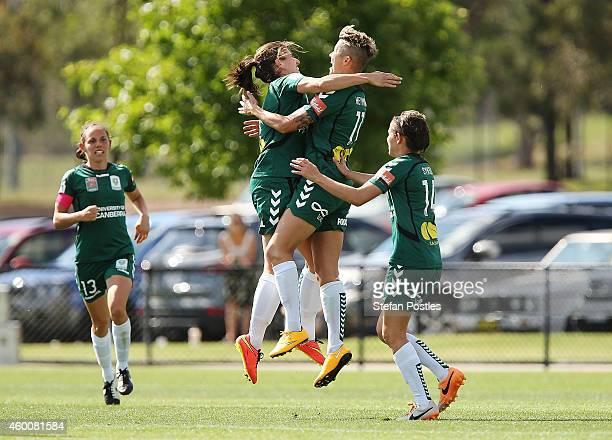 Canberra United players celebrate after a goal by Michelle Heyman during the round 12 WLeague match between Canberra United and Perth Glory at...