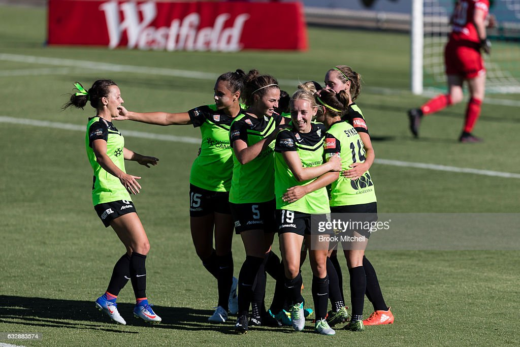 Canberra United players celebrate after an Ashleigh Sykes goal during the round 14 W-League match between Canberra United and Melbourne Victory at McKellar Park on January 28, 2017 in Canberra, Australia. United won the game 5-1.