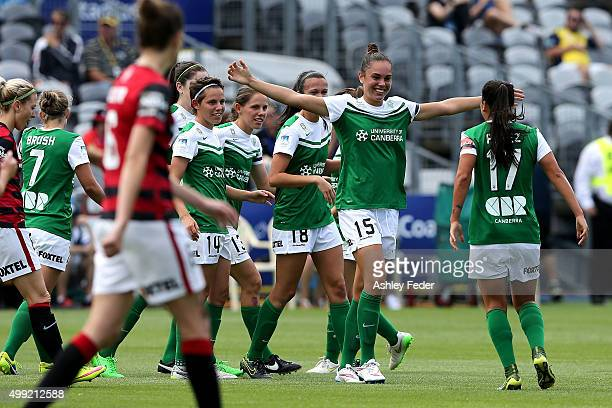 Canberra United team mates celebrate a goal during the round seven A-League match between the Western Sydney Wanderers and Canberra United at Central...