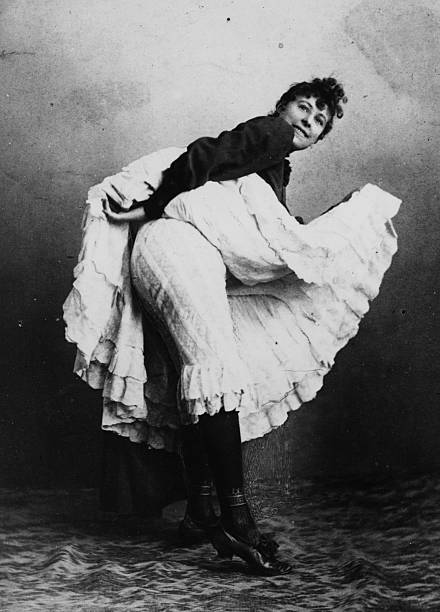 A can-can dancer from the Sans Souci shows off her...