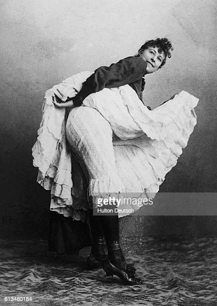 Cancan dancer lifts her skirt to reveal her bloomers.