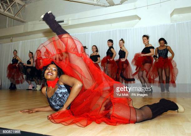 Cancan dancers from Pineapple Dance Studios perform on stage during the first day of the Vitality Show 2002 the largest event for complementary...