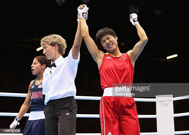 Cancan Ren of China celebrates her victory against Marlen Esparza of the United States during the Women's Fly Boxing on Day 12 of the London 2012...