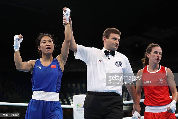 Cancan Ren of China celebrates her victory over Mandy Bujold of Canada in the boxing Women's Fly Quarterfinal 2 on Day 11 of the Rio 2016 Olympic...