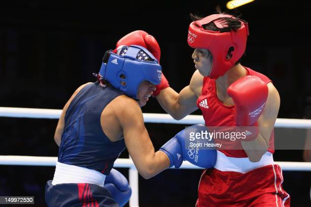 Cancan Ren of China in action with Marlen Esparza of the United States during the Women's Fly Boxing on Day 12 of the London 2012 Olympic Games at...