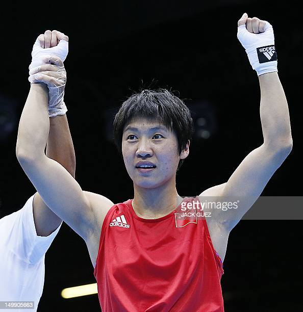 Cancan Ren of China is declared winner on points over Elena Savelyeva of Russia in the women's flyweight boxing quarterfinals of the 2012 London...