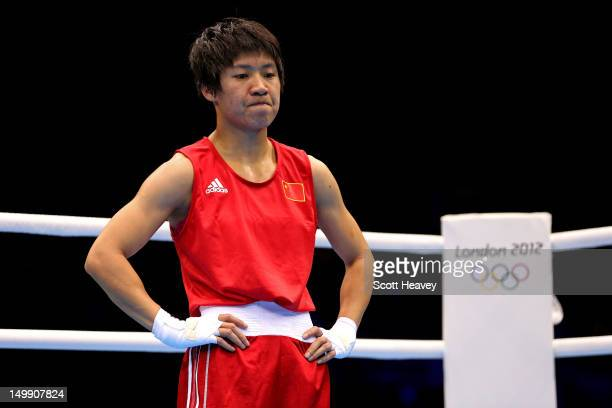 Cancan Ren of China looks on against Elena Savelyeva of Russia in the Women's Fly Boxing Quarterfinals on Day 10 of the London 2012 Olympic Games at...
