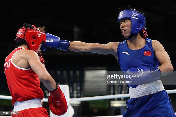Cancan Ren of China throws a right on Mandy Bujold of Canada in the boxing Women's Fly Quarterfinal 2 on Day 11 of the Rio 2016 Olympic Games at...