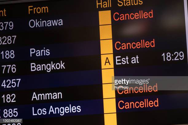 Cancelled flight are seen on the flight information display board inside the terminal of the Hong Kong International Airport on February 22, 2020 in...