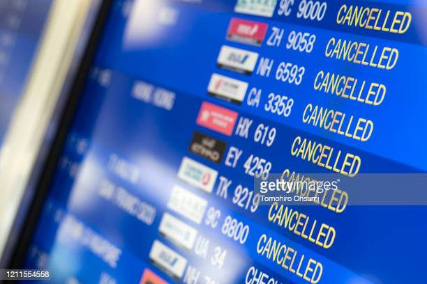 Cancelled flight information is displayed on a monitor in the departure hall at Kansai International Airport on March 10, 2020 in Osaka, Japan. The...