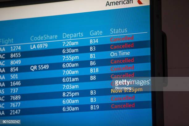 Cancelled flights are displayed on a departure board at Logan International Airport in Boston Massachusetts US on Wednesday Jan 3 2018 The worst...