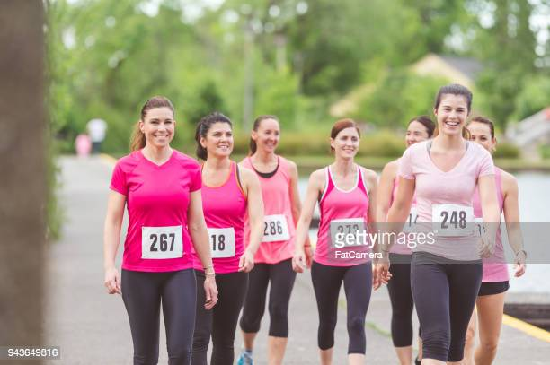 cancer fundraising run - charity benefit stock pictures, royalty-free photos & images