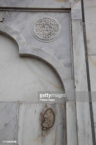 Cancer of the marble and yellowing seen at the Taj Mahal. On February 28, 2020 in Agra, India. The Taj Mahal after years of tourism and air pollution...