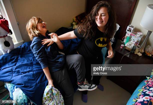 Cancer patient Alma Arzapalo left and her sister Angelica have a pillow fight in Alma's room at Brent's Place January 31 2018 Alma had just completed...