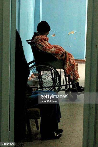 A cancer patient awaits treatment in the town hospital in this photo taken in January 2007 in the town of MailuuSuu in Kyrgystan According to the...